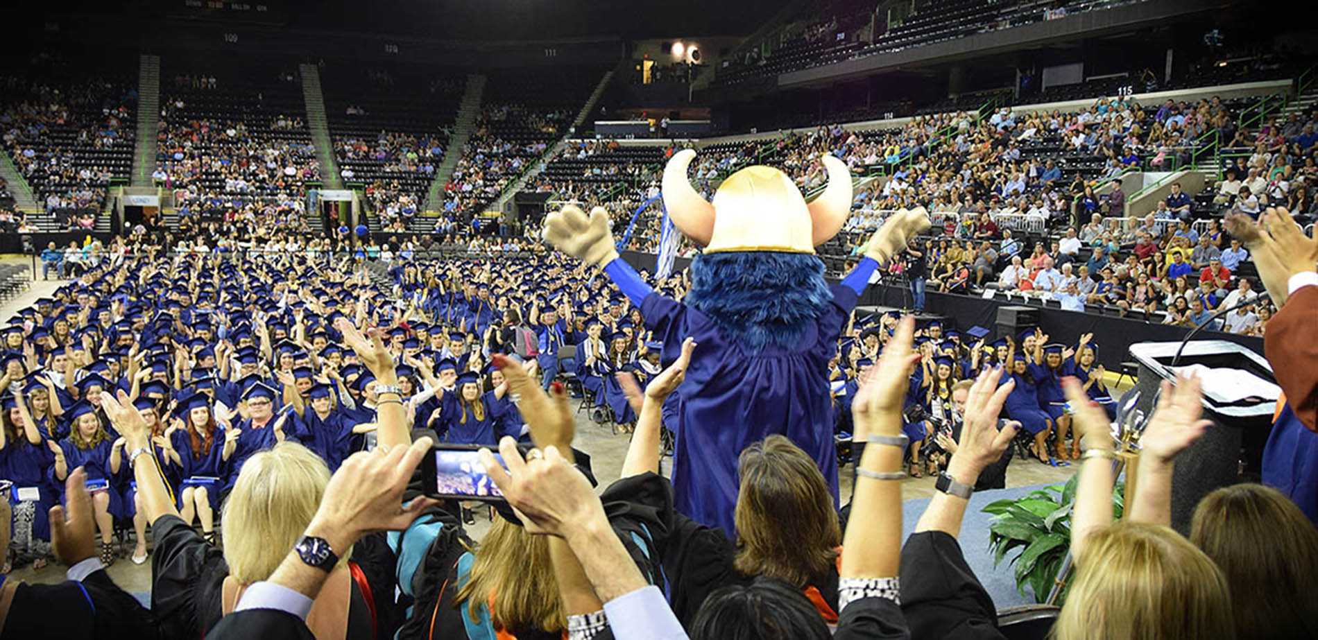 Valdar the Viking leading the Viking Clap at graduation
