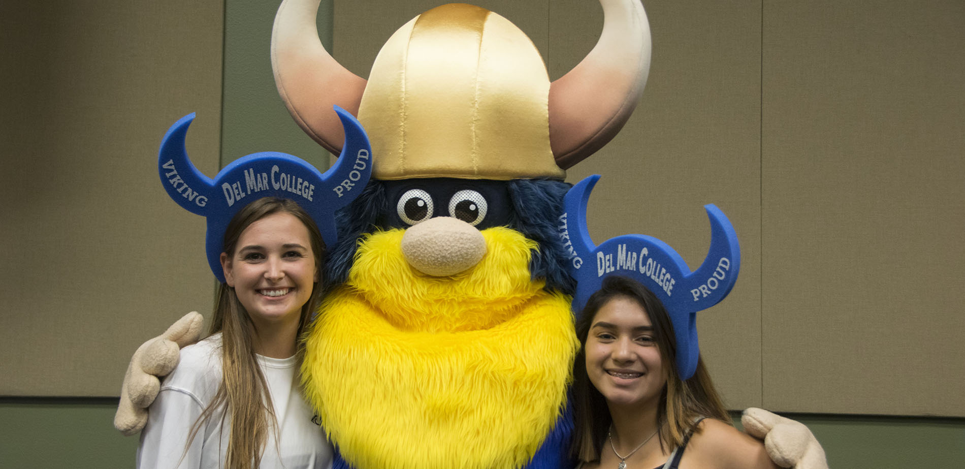 Prospective students at orientation with Valdar the Viking mascot