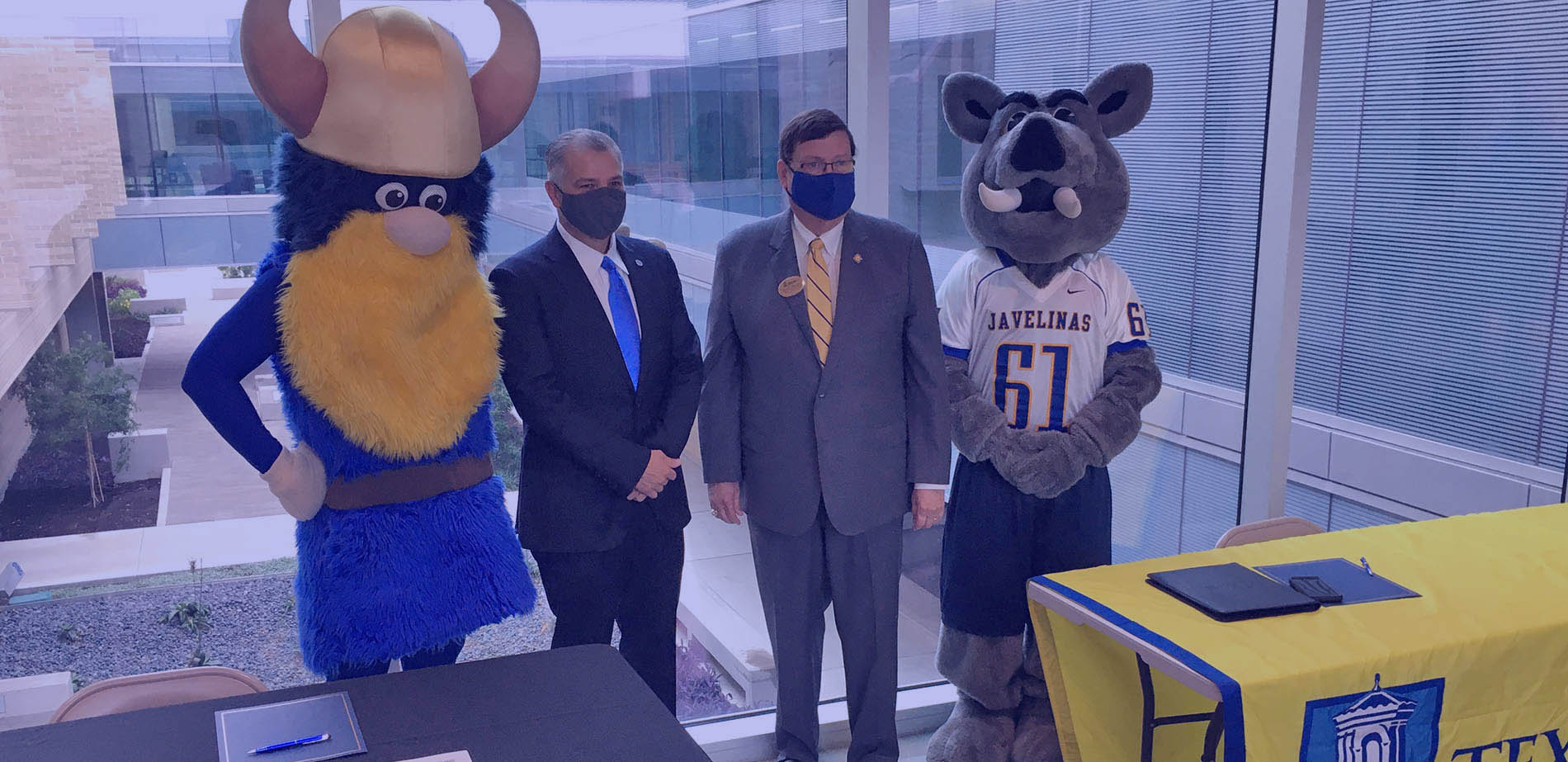 TAMUK and DMC presidents with their school mascots
