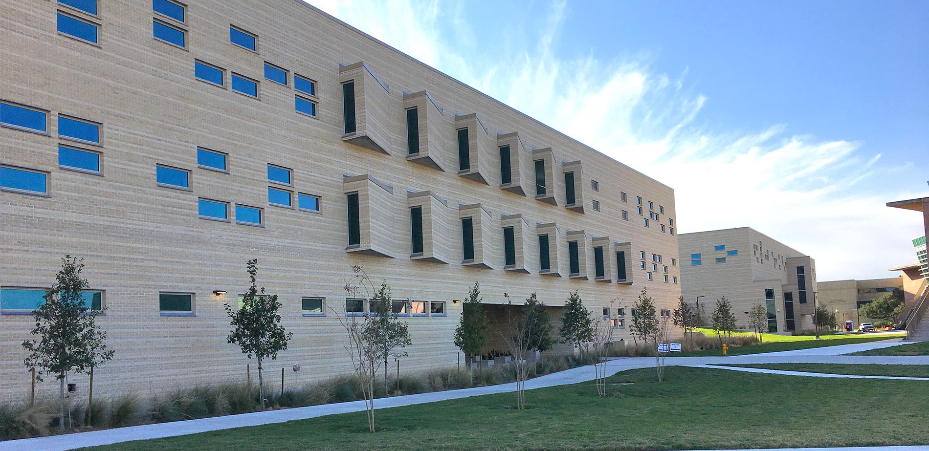 Ground-level image of the new General Academic and Music Building